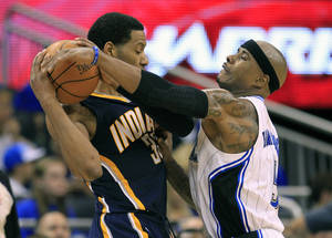 Photo -   Orlando Magic's Quentin Richardson, right, tries to get the ball away from Indiana Pacers' Danny Granger, left, during the first half of Game 3 of an NBA first-round playoff basketball series, Wednesday, May 2, 2012, in Orlando, Fla. (AP Photo/John Raoux)