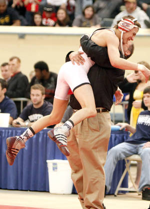 Photo - Kyle Garcia of Del City celebrates his win over Jakob Weis of Jenks with coach Ronnie James during the 6A 112-pound class, Saturday, Feb. 28, 2009, during the OSSAA State Wrestling tournament at the State Fair Arena in Oklahoma City. PHOTO BY SARAH PHIPPS, THE OKLAHOMAN