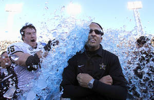 Photo - Vanderbilt coach James Franklin is doused by linebacker Chase Garnham (36) after they defeated Houston 41-24 in the BBVA Compass Bowl NCAA college football game on Saturday, Jan. 4, 2014, in Birmingham, Ala. (AP Photo/Butch Dill)