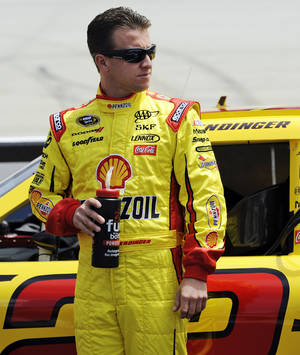 "photo -   FILE - In this June 2, 2012, file photo, driver AJ Allmendinger looks on during qualifying for the FedEx 400 benefiting Autism Speaks NASCAR Sprint Cup Series auto race in Dover, Del. Allmendinger has been reinstated by NASCAR on Tuesday, Sept. 18,2 012, after completing its ""Road to Recovery"" program. He was suspended in July for failing a random drug test a month earlier. (AP Photo/Nick Wass, File)"