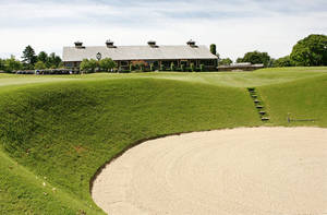 Photo - The clubhouse overlooks a bunker at the rededicated Oak Tree National on Wednesday in Edmond. Owners are looking to attract big-time tournaments. Photo by Jim Beckel, The Oklahoman