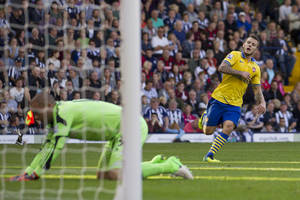 Photo - Arsenal's Jack Wilshere, right, celebrates after scoring past West Bromwich's goalkeeper Boaz Myhill, left, during their English Premier League soccer match at The Hawthorns Stadium, West Bromwich, England, Sunday Oct. 6, 2013. (AP Photo/Jon Super)