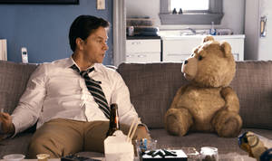 "Photo -   This film image released by Universal Pictures shows Mark Wahlberg, left with the character Ted, voiced by Seth MacFarlane in a scene from ""Ted."" (AP Photo/Universal Pictures)"
