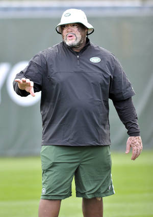 Photo - Jets defensive line coach Karl Dunbar was an assistant coach at Oklahoma State. AP photo