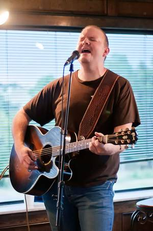 Bo Phillips plays during a recent show at Cushing Country Club. John Cooper, a member of the Red Dirt Rangers, hosts the Third Thursday Concert Series at the country club. Photo by Stacey Lauren of C Sharp Studios - Cushing, OK <strong></strong>