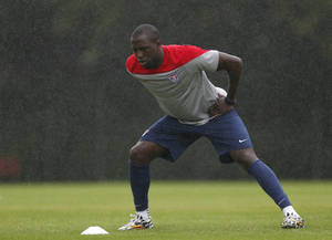 Photo - Light rain falls as United States' Jozy Altidore stretches during a training session at the Sao Paulo FC training center in Sao Paulo, Brazil, Tuesday, June 10, 2014. The U.S. will play in group G of the 2014 soccer World Cup. (AP Photo/Julio Cortez)