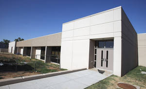Photo - An exterior shot of Whittier Middle School in Norman.