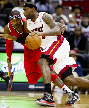 Photo -   Miami Heat forward LeBron James (6) drives against Atlanta Hawks forward Josh Smith (5) in the first half of an NBA basketball game in Atlanta, Friday, Nov. 9, 2012. (AP Photo/John Bazemore)