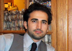 Photo - FILE - This undated file photo released by his family via FreeAmir.org shows Amir Hekmati. Hekmati, a former U.S. Marine being held in Iran over the past two years on accusations of spying for the CIA. The former U.S. Marine convicted of criminal charges in Iran after being accused of working for the CIA will appeal for a new trial after already seeing his sentence reduced once, an Iranian news agency reported Sunday, May 25, 2014.(AP Photo/Hekmati family via FreeAmir.org, File)