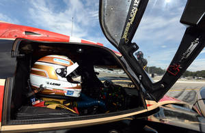 Photo - Neel Jani, of Switzerland, sits in the Rebellion Racing Lola B12/60 before qualifying for the American Le Mans Series' Petit Le Mans auto race at Road Atlanta, Friday, Oct. 18, 2013, in Braselton, Ga. (AP Photo/Rainier Ehrhardt)