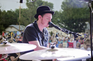 Photo - Grammy nominated singer-songwriter John Fullbright of Okemah, Oklahoma, plays to a crowd of 4000 in Norman's Lions Park as part of their Summer Breeze Concert Series. The concert series is presented by the Performing Arts Studio of Norman. Photo by M. Tim Blake, for The Oklahoman