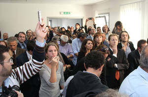 "Photo -   People listen to the verdict at L'Aquila court, Italy, Monday, Oct. 22, 2012. An Italian court has convicted seven scientists and experts of manslaughter for failing to adequately warn citizens before an earthquake struck central Italy in 2009, killing more than 300 people. The court in L'Aquila Monday evening handed down the convictions and six-year-prison sentences to the defendants, members of a national ""Great Risks Commission."" In Italy, convictions aren't definitive until after at least one level of appeals, so it is unlikely any of the defendants would face jail immediately. Scientists worldwide had decried the trial as ridiculous, contending that science has no way to predict quakes. (AP Photo/Raniero Pizzi)"