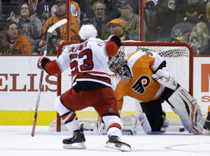 photo - Carolina Hurricanes' Jeff Skinner, left, reacts after scoring a goal past Philadelphia Flyers' Ilya Bryzgalov, of Russia, during the second period of an NHL hockey game, Saturday, Feb. 9, 2013, in Philadelphia. (AP Photo/Matt Slocum)