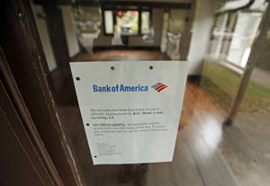 Photo - This Bank of America foreclosure notice is in the front window of a home in Los Angeles. AP Photo