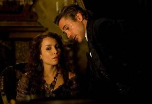 "Photo - Noomi Rapace and Robert Downey Jr. star in ""Sherlock Holmes: A Game of Shadows."" Warner Bros. Pictures photo"