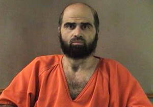 Photo - FILE - This undated file photo provided by the Bell County Sheriff's Department shows Nidal Hasan, the Army psychiatrist charged in the 2009 Fort Hood shooting rampage that left 13 dead. Tight security measures are in place at the Texas Army post and neighboring city of Killeen in preparation for the start of jury selection Tuesday, July 9, 2013, Hasan's capital murder trial. (AP Photo/Bell County Sheriff's Department, File)
