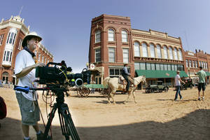 "Photo - Camera operator Dan Jackson between takes on the movie set of ""Pearl"" on Harrison Avenue in Guthrie, Okla. September 27, 2008.  BY STEVE GOOCH, THE  OKLAHOMAN.  ORG XMIT: KOD <strong>Steve Gooch - The Oklahoman</strong>"