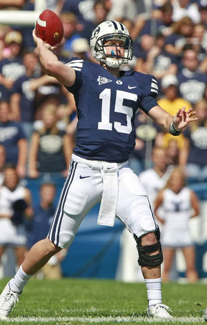 Photo - BYU quarterback Max Hall leads the Cougars against the Sooners on Sept. 5. AP photo