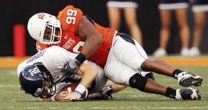 Photo - OSU's Richetti Jones sacks Rice quarterback John Thomas Shepherd during last year's game in Stillwater. PHOTO BY NATE BILLINGS, THE OKLAHOMAN