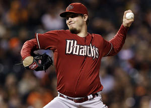 Photo -   Arizona Diamondbacks starting pitcher Wade Miley throws to the San Francisco Giants during the first inning of a baseball game, Wednesday, Sept. 26, 2012, in San Francisco. (AP Photo/Marcio Jose Sanchez)