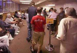 photo - File photo of long lines waiting to take driver's license tests at the Edmond office by Paul Hellstern