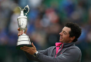 Photo - Rory McIlroy of Northern Ireland holds up the Claret Jug trophy after winning the British Open Golf championship at the Royal Liverpool golf club, Hoylake, England, Sunday July 20, 2014. (AP Photo/Scott Heppell)