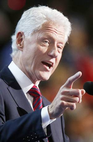 Photo - Former President Bill Clinton addresses the Democratic National Convention in Charlotte, N.C., on Wednesday, Sept. 5, 2012. (AP Photo/Jae C. Hong)  ORG XMIT: DNC782