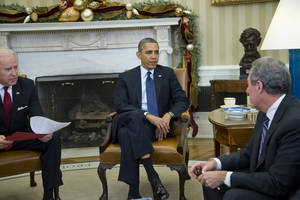 Photo - President Barack Obama and Vice President Joe Biden meet with U.S. Trade Representative Michael Froman in the Oval Office of the White House in Washington, Monday, Dec. 16, 2013. (AP Photo/ Evan Vucci)