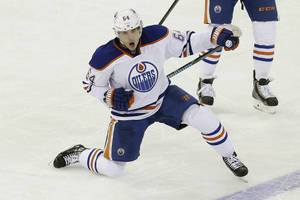 Photo - Edmonton Oilers' Nail Yakupov (64), of Russia, celebrates after scoring a goal during the third period of an NHL hockey game against the New York Rangers, Thursday, Feb. 6, 2014, in New York. The Oilers won the game 2-1. (AP Photo/Frank Franklin II)
