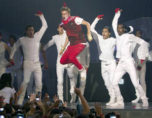 Photo -   Justin Bieber performs during the 2012 Much Music Video Awards in Toronto on Sunday, June 17, 2012. (AP Photo/The Canadian Press, Chris Young)