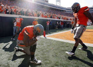Photo - Oklahoma State's Kye Staley (9) celebrates a touchdown as Joseph Randle (1) looks on during a college football game between the Oklahoma State University Cowboys (OSU) and the Baylor University Bears (BU) at Boone Pickens Stadium in Stillwater, Okla., Saturday, Oct. 29, 2011. Photo by Sarah Phipps, The Oklahoman