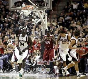 Photo -  Gonzaga's Bol Kong (34) gets out of the way after a dunk by Oklahoma's Tiny Gallon (24) shattered the backboard during the second half of an NCAA college basketball game in Spokane, Wash., Thursday, Dec. 31, 2009. AP Photo