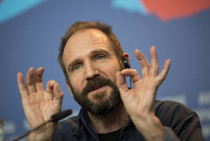 "Photo - FILE - This is a Thursday, Feb. 6, 2014 file photo of actor Ralph Fiennes as he answers journalists questions at the press conference for the film The Grand Budapest Hotel during the International Film Festival Berlinale, in Berlin.  New plays by theatrical giants Tom Stoppard and David Hare and the stage return of Ralph Fiennes are highlights of the next year at Britain's National Theatre. The theater announced Thursday March 20, 2014 that Hare's adaptation of Katherine Boo's acclaimed book about Mumbai, ""Behind the Beautiful Forevers,"" will open in November. Stoppard's as-yet-untitled play will run from January 2015. Fiennes — currently onscreen in Wes Anderson's ""The Grand Budapest Hotel"" — will star in George Bernard Shaw's political-philosophical drama ""Man and Superman"" from February. (AP Photo/Axel Schmidt, File)"