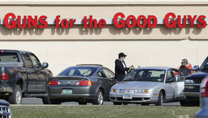 Photo - Shoppers leave Hoffman's Gun Center with their purchases in Newington, Conn., Tuesday, April 2, 2013. Customers are packing gun stores around Connecticut following the unveiling of new gun-control legislation, which could take effect as soon as Wednesday evening. (AP Photo/Charles Krupa)