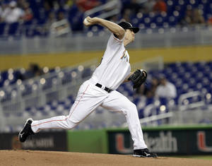 Miami Marlins' Kevin Slowey throws to the Philadelphia Phillies in the first inning of a baseball game in Miami, Wednesday, May 22, 2013. (AP Photo/Alan Diaz)