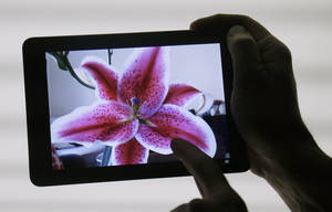 photo -   The iPad Mini is shown in San Jose, Calif., Tuesday, Oct. 23, 2012. The device has a screen that's about two-thirds the size of the full-size model, and Apple says it will cost $329 and up. (AP Photo/Marcio Jose Sanchez)