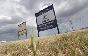 Photo - FILE - In this Aug. 13, 2013, file photo, a sign announces the future of the Dallas Cowboys football team headquarters and training facility in Frisco, Texas. New data from the Census Bureau shows that three of the nation's five fastest-growing cities are located in the Lone Star State. San Marcos, Frisco and Cedar Park, Texas were No. 1, 2 and 4 in percentage population growth between 2012 and 2013.  (AP Photo/LM Otero, File)