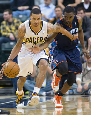 photo - Indiana Pacers' George Hill (3) drives against Charlotte Bobcats' Ben Gordon (8) during the second half of an NBA basketball game in Indianapolis, Saturday, Jan. 12, 2013. The Pacers defeated the Bobcats 96-88. (AP Photo/Doug McSchooler)