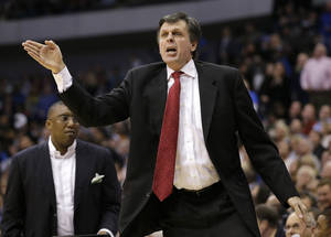 photo - Houston Rockets head coach Kevin McHale shouts at an official looking for a foul call against the Dallas Mavericks in the second half of an NBA basketball game, Wednesday, March 6, 2013, in Dallas. The Mavericks won 112-108. (AP Photo/Tony Gutierrez)