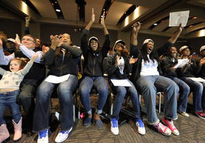 Photo - Middle Tennessee State University Women's Baskettball Coach Rick Insell, left,with granddaughter Carter Insell 3 1/2,  and MTSU players from left to right, Keke Stewart, Ebony Rowe, Janay Brinkley, Janiece Johnson, Shanice Cason and Olivia Jones react as the Middle Tennessee women's basketball team receives its NCAA tournament bid to play Oregon State in the NCAA tournament, during a watch party on Monday, March 17, 2014, in Murfreesboro, Tenn. (AP Photo/Daily News Journal, Helen Comer)   NO SALES