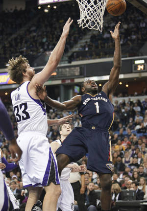 Photo - New Orleans Pelicans guard Tyreke Evans (1) drives to the basket against Sacramento Kings defender Aaron Gray (33) during the first half of an NBA basketball game in Sacramento, Calif., on Monday, Dec. 23, 2013. (AP PhotoSteve Yeater)