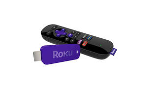 Photo - This undated image provided by Roku, shows the Roku Streaming stick. Roku is getting into an Internet video-streaming stick fight with Google's Chromecast.Like the similarly shaped Chromecast, Roku's thumb-sized device plugs into a TV's HDMI port and feeds Internet video through a Wi-Fi connection. (AP Photo/ Roku)