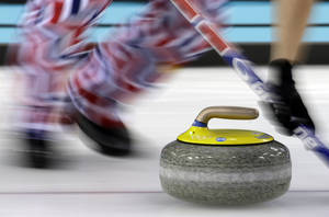 Photo - Norway's Haavard Vad Petersson sweeps  during a round robin session against the Great Britain at the 2014 Winter Olympics, Sunday, Feb. 16, 2014, in Sochi, Russia. (AP Photo/Morry Gash)