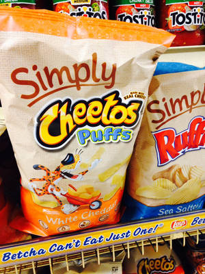 "Photo - Simply Cheetos are displayed in New York on Friday, Jan. 24, 2014. PepsiCo has quietly gotten rid of the word ""Natural"" in some of its products and instead is going with ""Simply."" (AP Photo/Candice Choi)"
