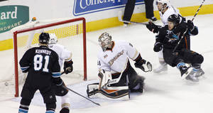 Photo - San Jose Sharks' Bracken Kearns, right, falls back after scoring a goal past Anaheim Ducks goalie Frederik Andersen during the second period of an NHL hockey game, Sunday, Dec. 29, 2013 in San Jose, Calif. (AP Photo/George Nikitin)