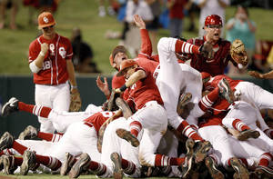 Photo - The OU team, including, Garrett Buechele, left, Caleb Bushyhead, Jarrett Semler, and Bryan Goth celebrate after their win in the NCAA regional baseball game between Oklahoma and North Carolina at L. Dale Mitchell Park in Norman, Okla., Sunday, June 6, 2010. Photo by Bryan Terry, The Oklahoman