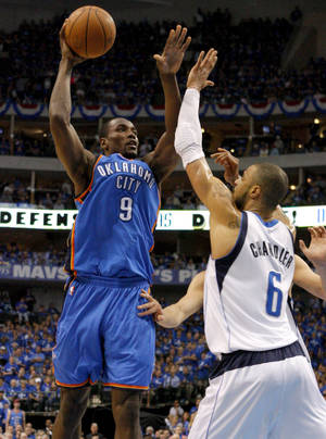 photo - Oklahoma City&#039;s Serge Ibaka (9) shoots the ball over Tyson Chandler (6) of Dallas during game 2 of the Western Conference Finals in the NBA basketball playoffs between the Dallas Mavericks and the Oklahoma City Thunder at American Airlines Center in Dallas, Thursday, May 19, 2011. Photo by Bryan Terry, The Oklahoman