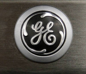 photo - FILE - In this Monday, Sept. 10, 2012 file photo, a General Electric logo is seen on a kitchen stove at a Lowe's store in Framingham, Mass. General Electric Co. is reporting, Friday, Jan. 18, 2013, that net income rose 8 percent in the fourth quarter as earnings at all of the conglomerate's industrial segments improved due to growth in developing economies. (AP Photo/Steven Senne, File)