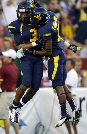 Photo -   West Virginia wide receivers Stedman Bailey, left, and Jordan Thompson, celebrate Stedman's touchdown reception during the second half of an NCAA college football game against James Madison Saturday, Sept. 15, 2012, in Landover, Md. West Virginia won 42-12. (AP Photo/Alex Brandon)
