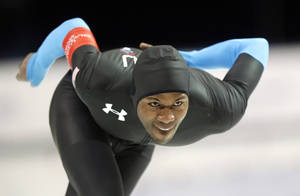 Photo - Shani Davis, of the United States, competes in the men's 1,000-meter rave during the U.S. Olympic speedskating trials Sunday, Dec. 29, 2013, in Kearns, Utah. Davis finished first. (AP Photo/Rick Bowmer)